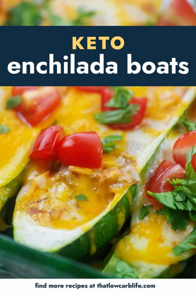 zucchini boats topped with tomatoes and cilantro in baking dish.