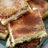 keto snickerdoodle cheesecake bars piled in metal dish.