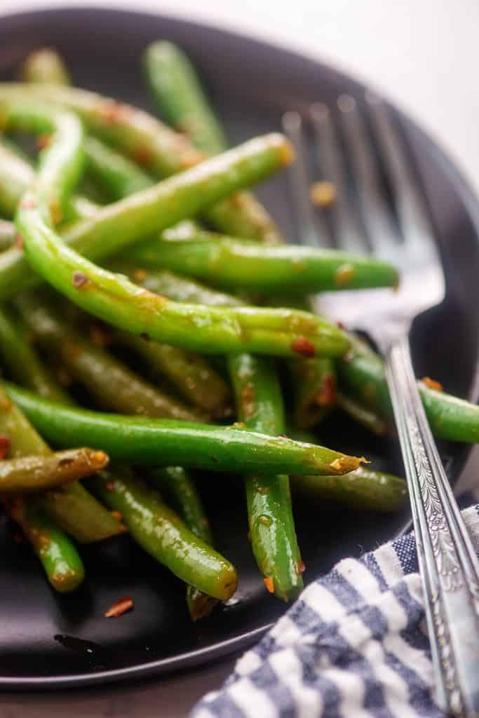 black plate full of keto Asian green beans.