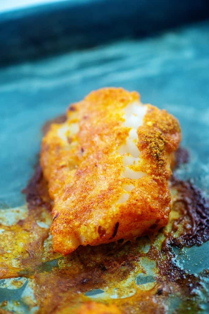 baked cod on baking sheet.