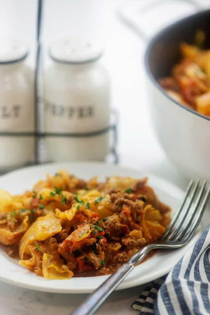 cabbage casserole on white plate.