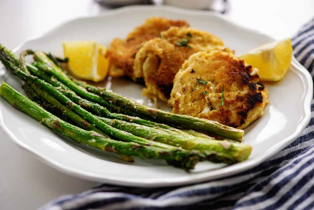 air fryer asparagus and keto crab cakes on white plate.