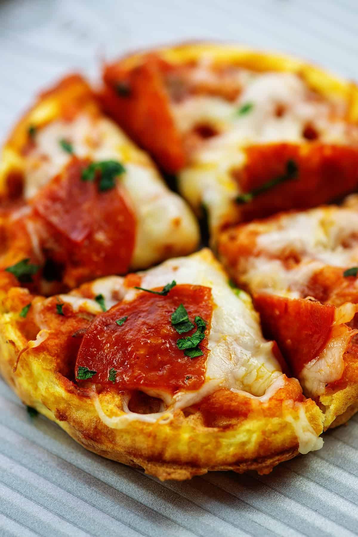 sliced pizza on baking sheet.