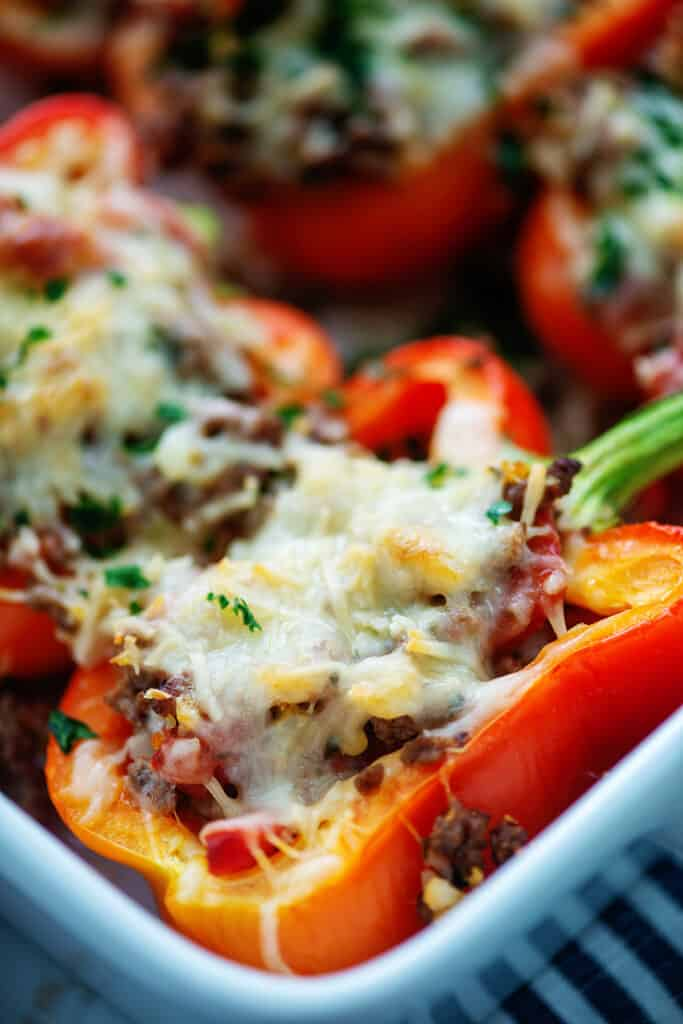 low carb Italian stuffed peppers in white baking dish.