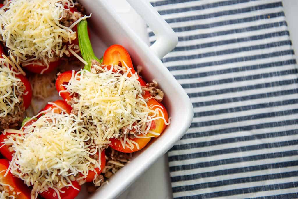 peppers stuffed with cauliflower rice and beef and topped with cheese.
