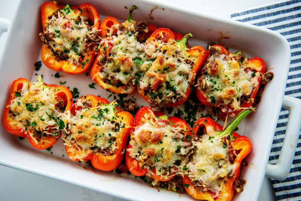 stuffed peppers in white dish after baking.