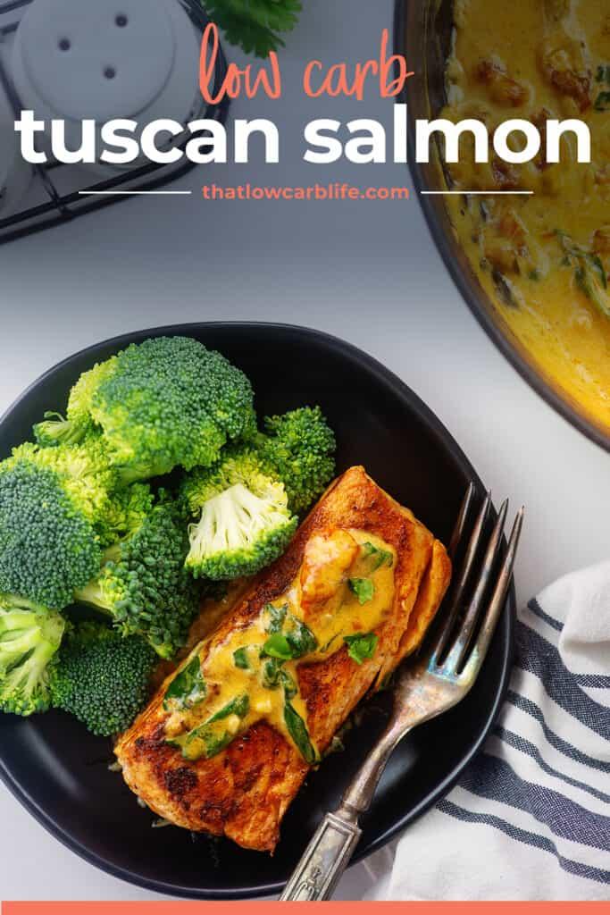 Tuscan salmon recipe on black plate.