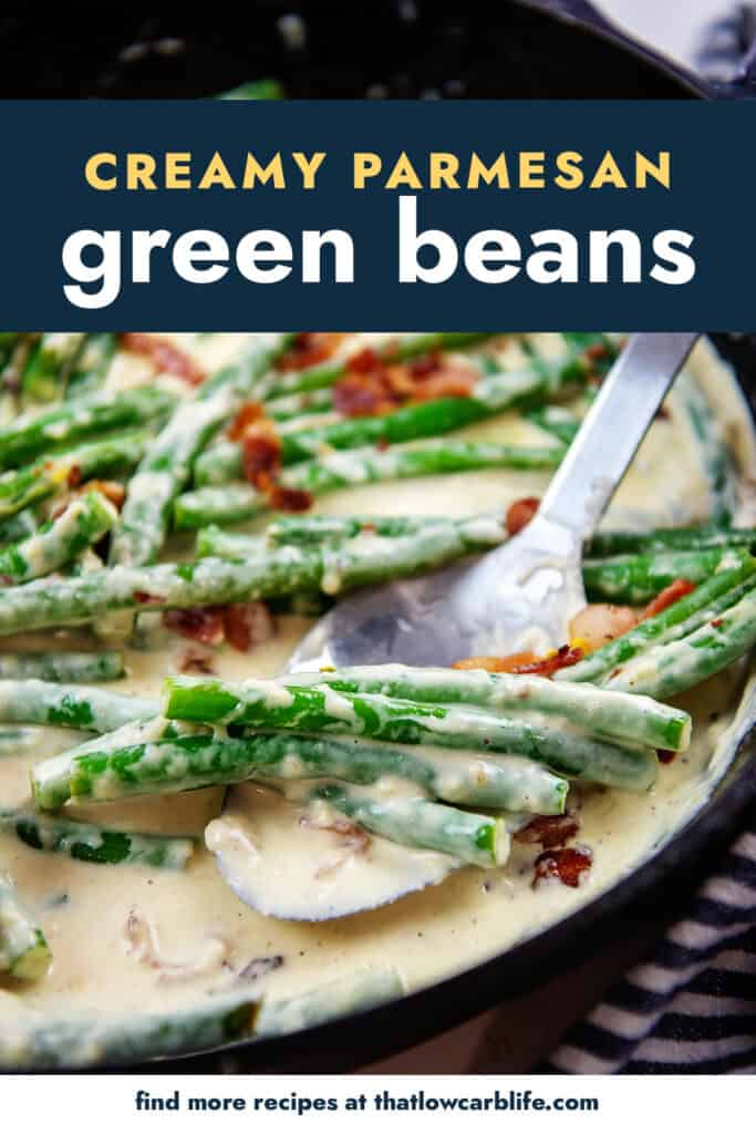 green beans in cream sauce on a spoon in a cast iron skillet.