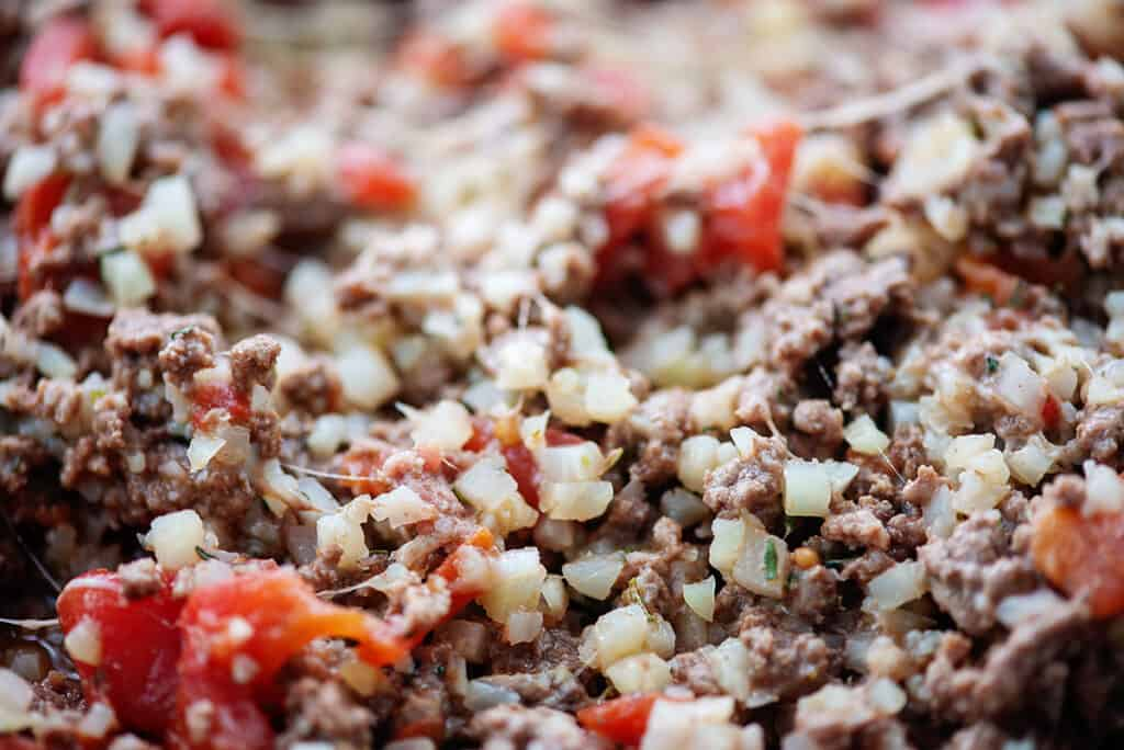 filling for Italian stuffed peppers made of cauliflower rice, beef, and Italian flavors.