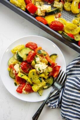 baked feta veggies on white plate.