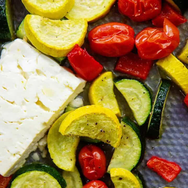 roasted vegetables with feta cheese on sheet pan.