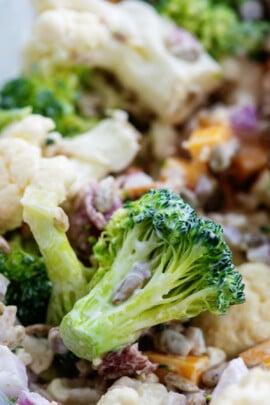 broccoli cauliflower salad recipe in bowl.