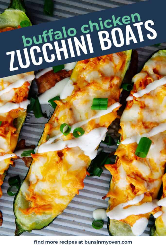 spicy buffalo chicken stuffed zucchini on cookie sheet.