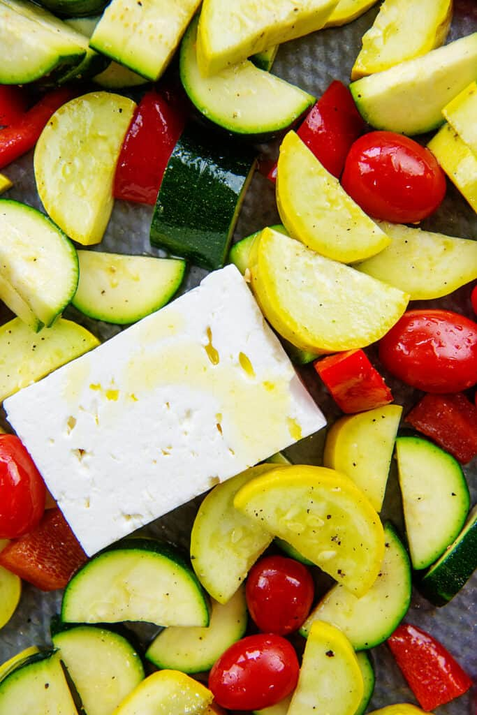feta and vegetables on sheet pan.