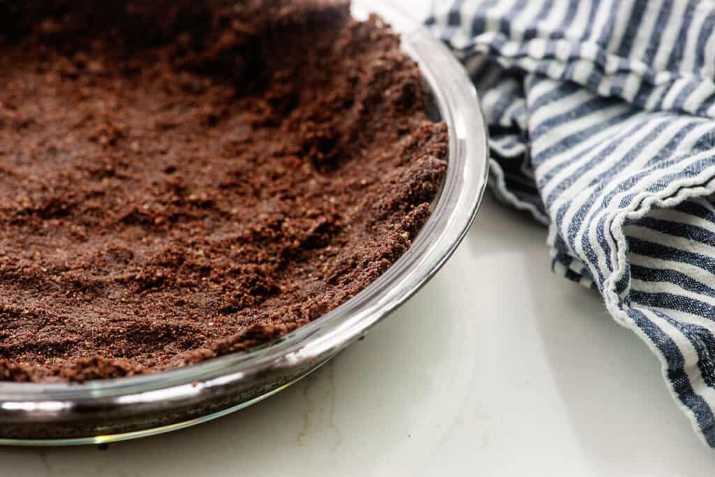 keto chocolate pie crust in glass pie plate.