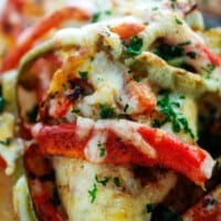 fajita baked chicken with strips of vegetables and cheese.