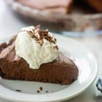 chocolate pie on white plate.