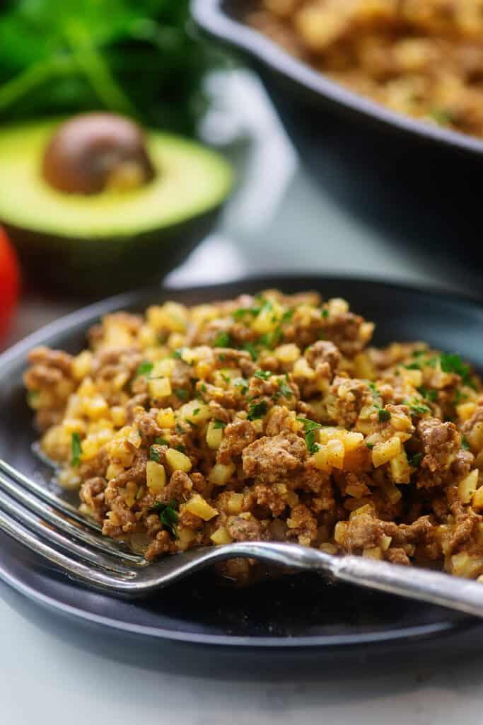 keto Mexican skillet recipe on black plate.