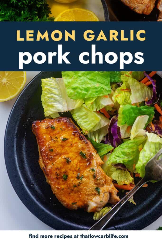 pork chops and salad on black plate.