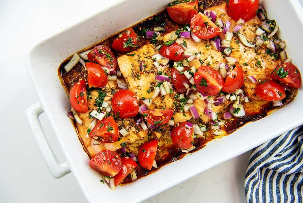 baked salmon topped with tomato bruschetta mixture.