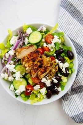 greek salad in white bowl.