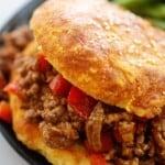 sloppy joe recipe on keto bun on black plate.
