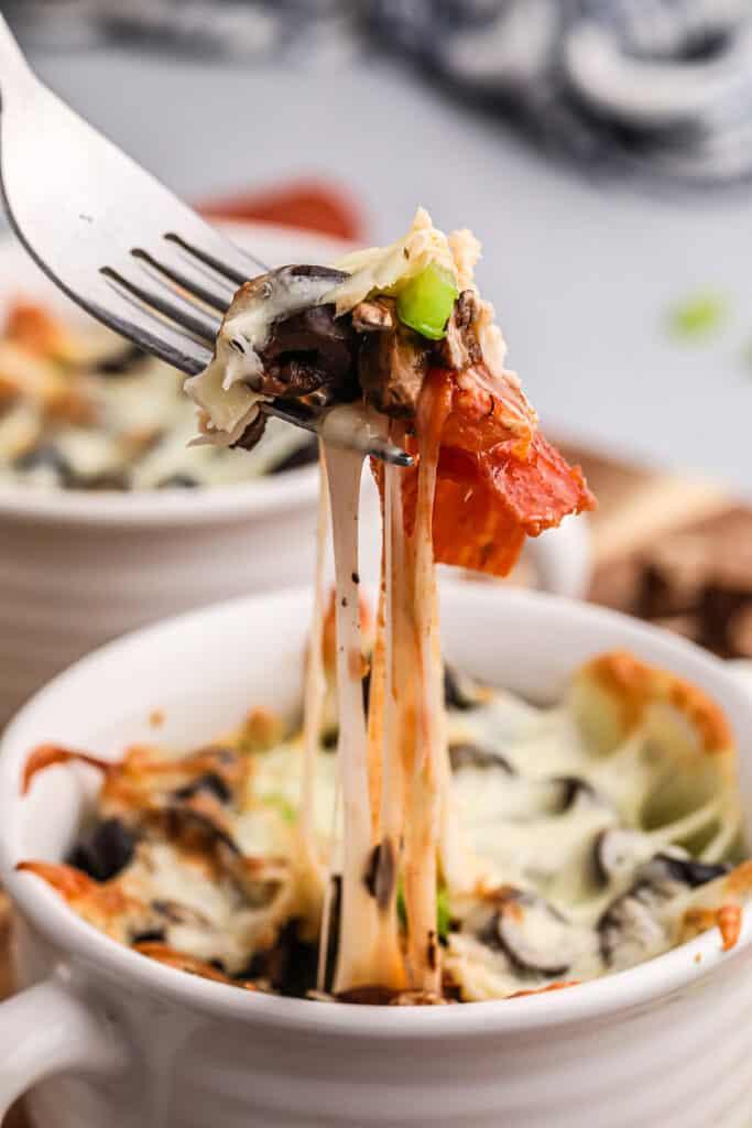 keto crustless pizza on fork.
