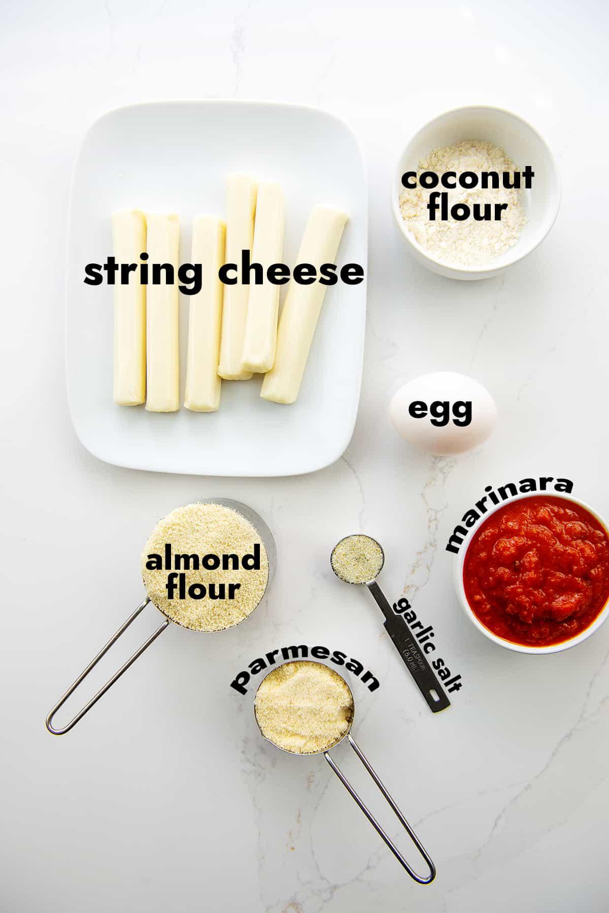 ingredients for mozzarella sticks on white counter.