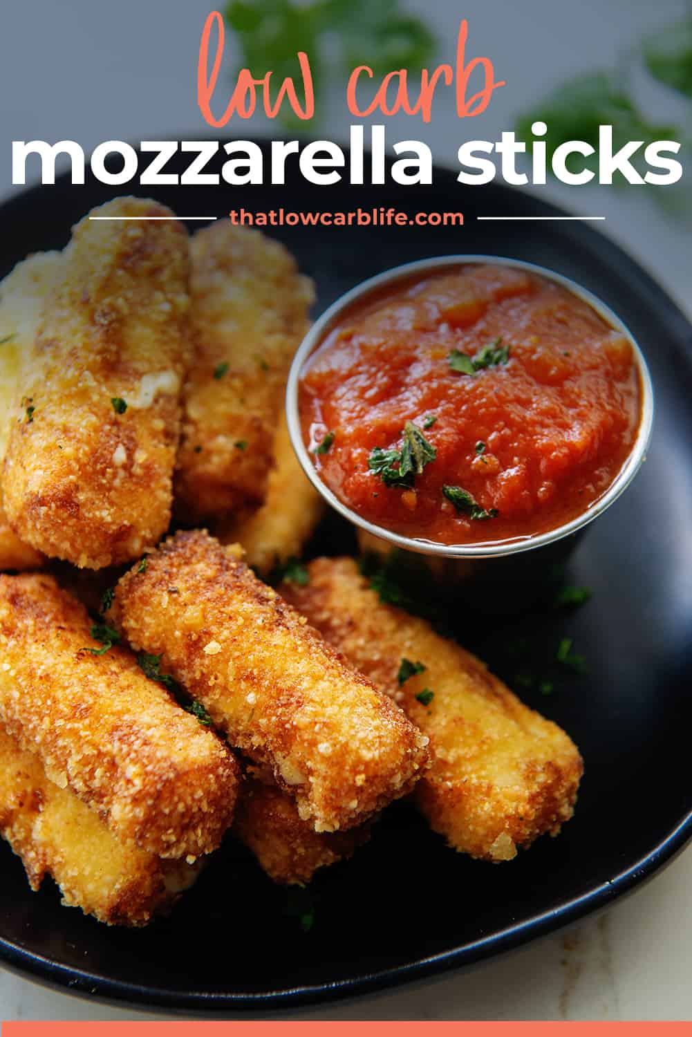 low carb mozzarella sticks on black plate with text for Pinterest.