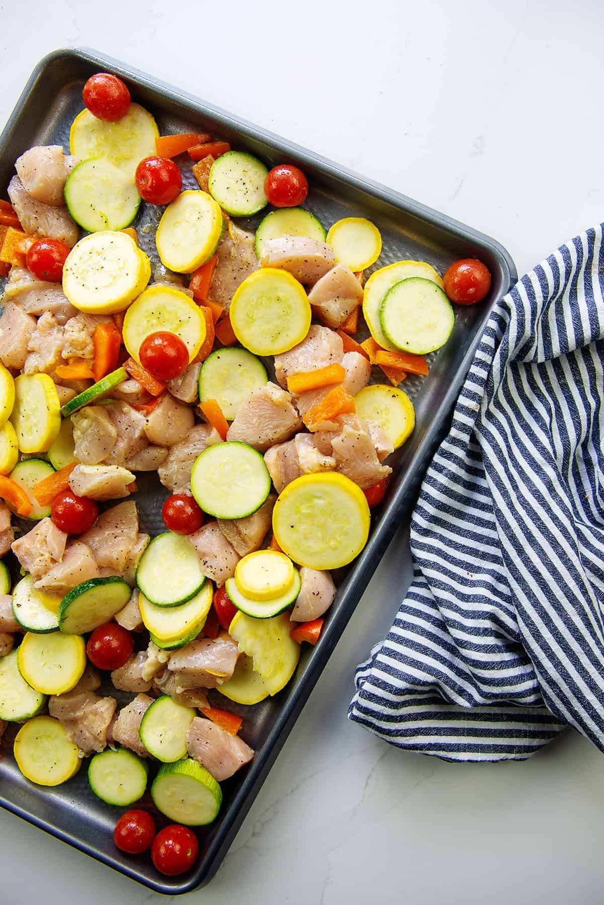 chicken and vegetables on sheet pan.