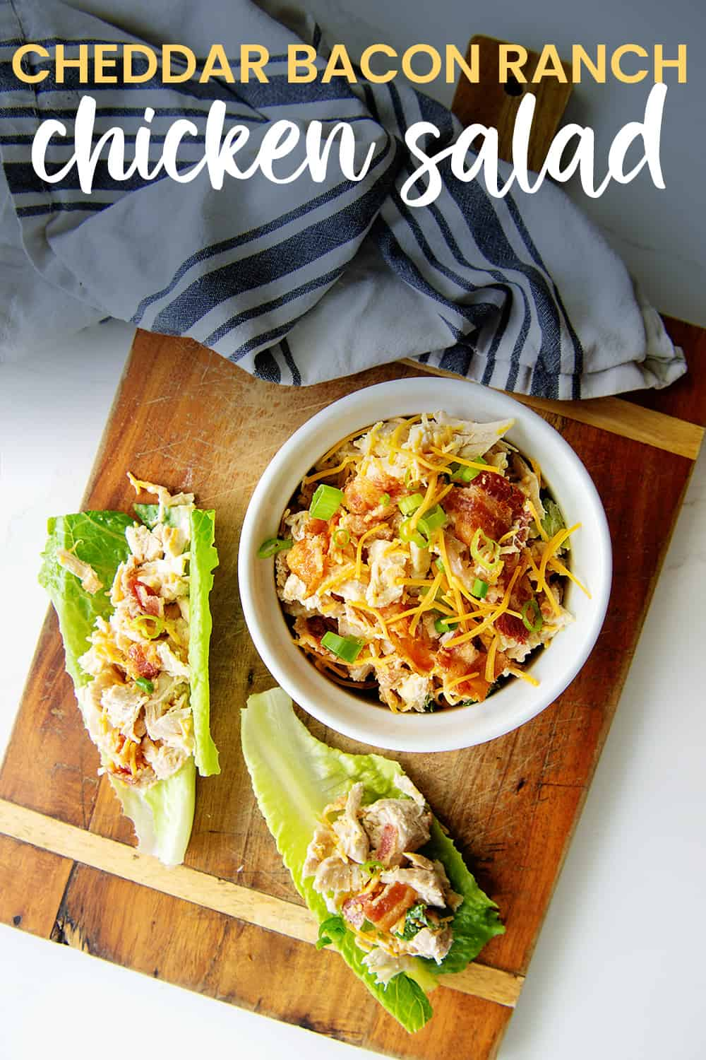 overhead view of chicken salad on cutting board with text for pinterest.