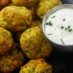 cheesy broccoli tots piled next to ranch dressing.