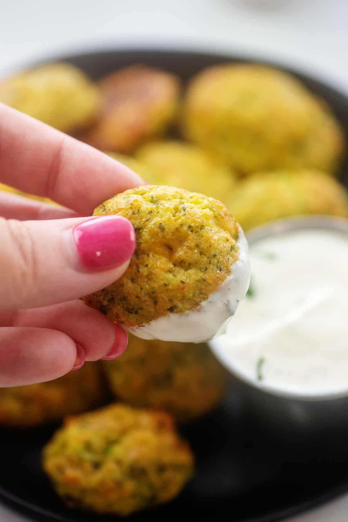 broccoli tot being dipped in ranch dressing.