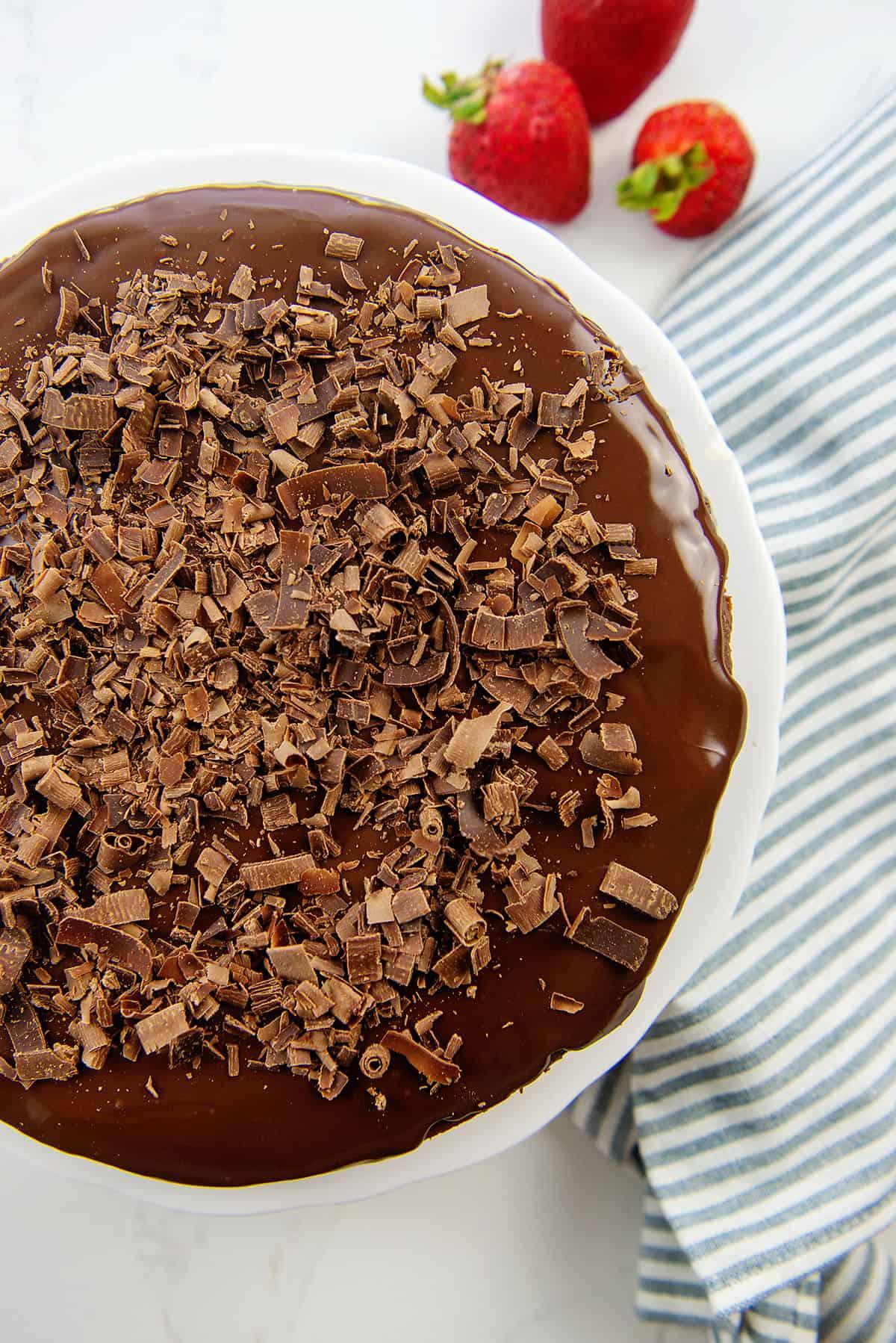 keto chocolate cheesecake on cake plate.