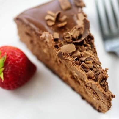 slice of chocolate cheesecake on white plate.
