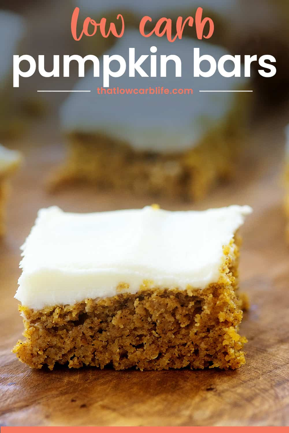 keto pumpkin bar on wooden cutting board with text for Pinterest.