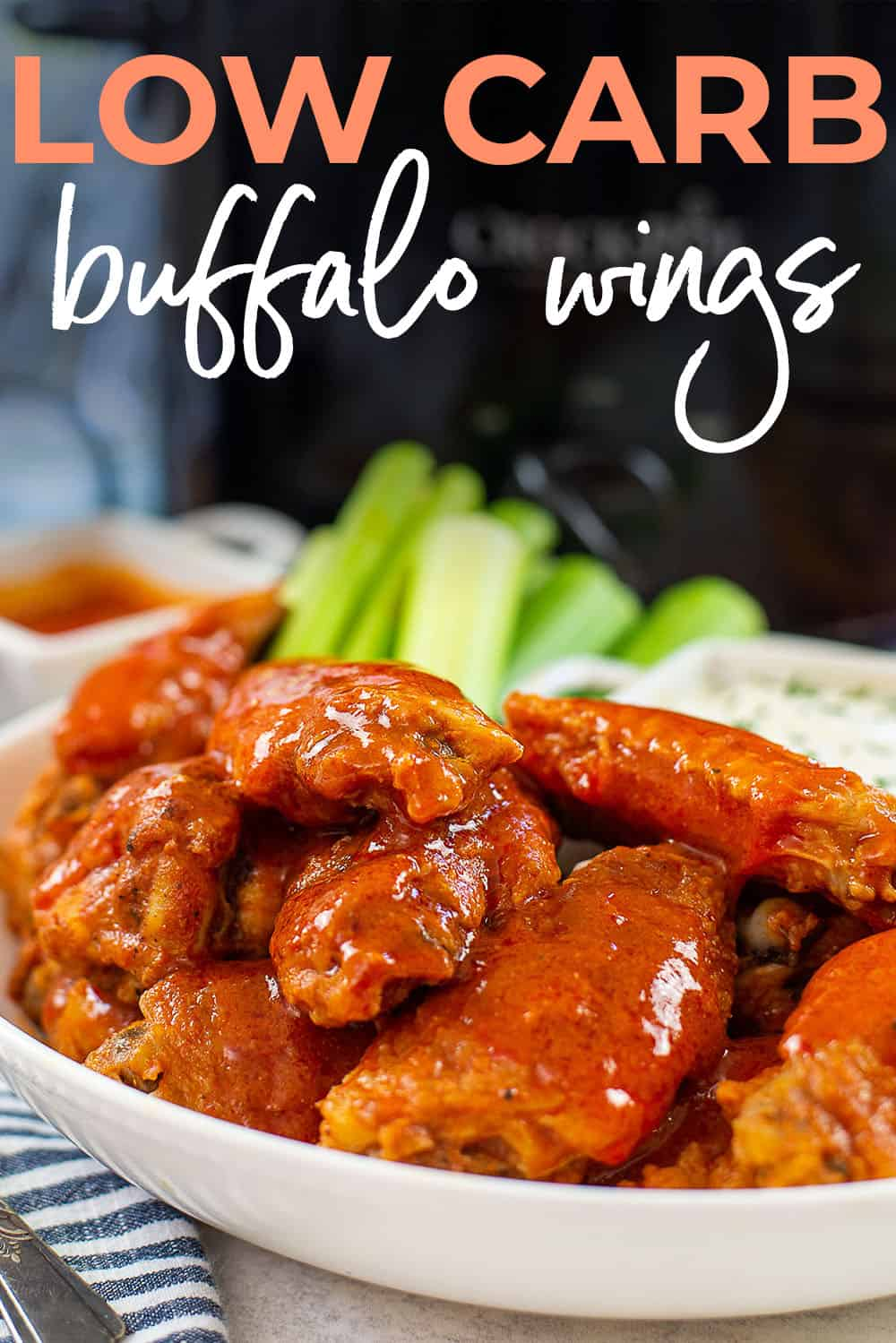 slow cooker wings in white dish.