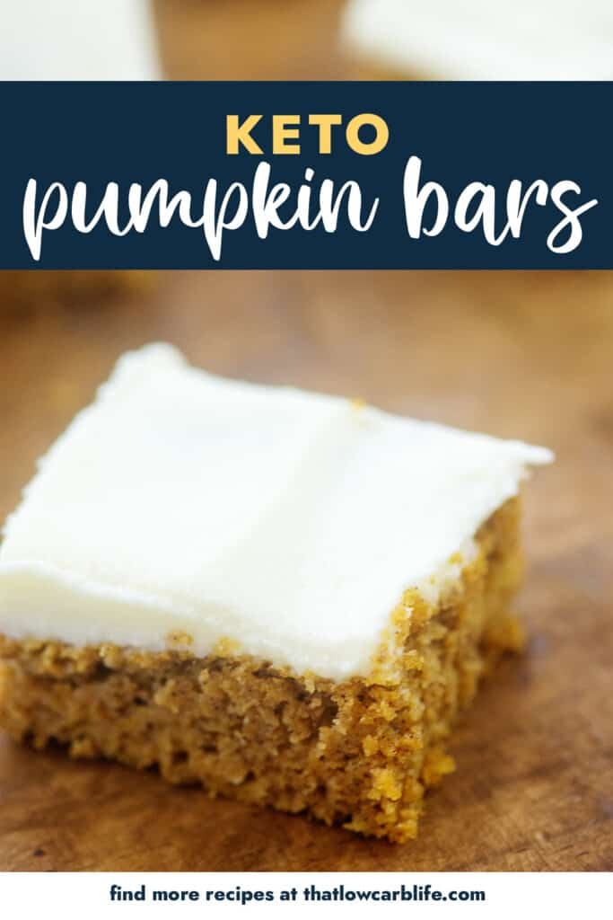 frosted pumpkin bar on wooden cutting board.