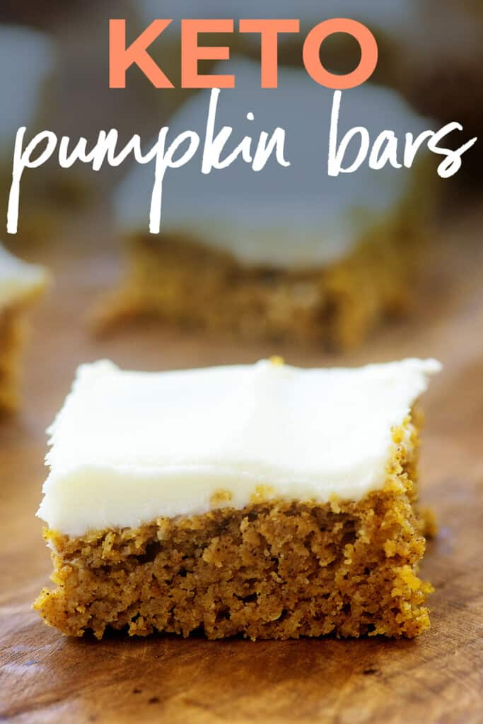 pumpkin bar with cream cheese frosting on wooden board with text for Pinterest.