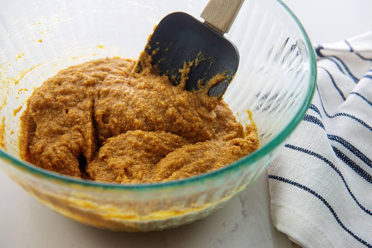 pumpkin bar batter in glass mixing bowl.